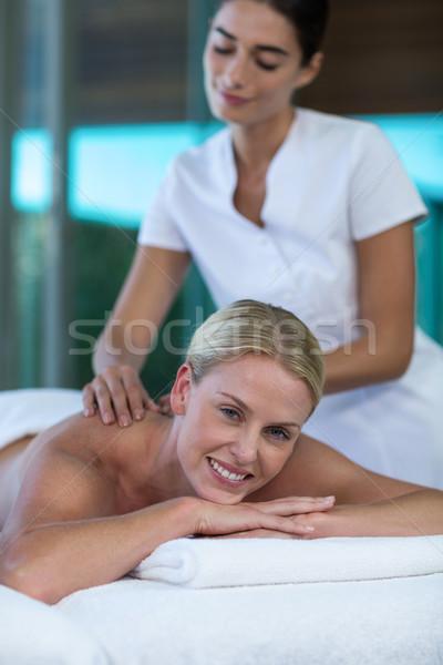 Woman receiving back massage from masseur Stock photo © wavebreak_media