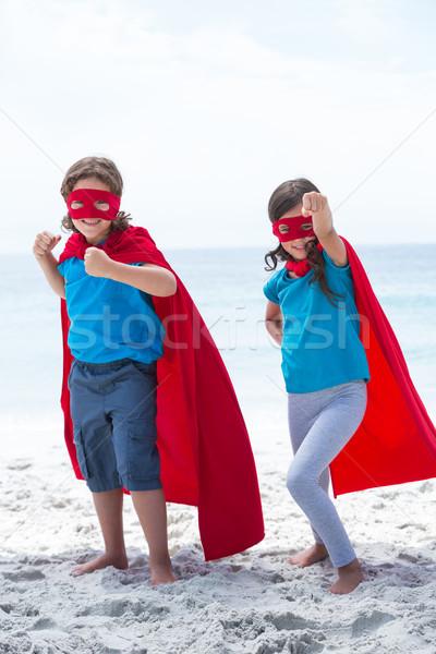 Siblings in superhero costume at beach  Stock photo © wavebreak_media