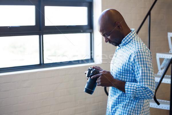 Man checking photo in camera Stock photo © wavebreak_media