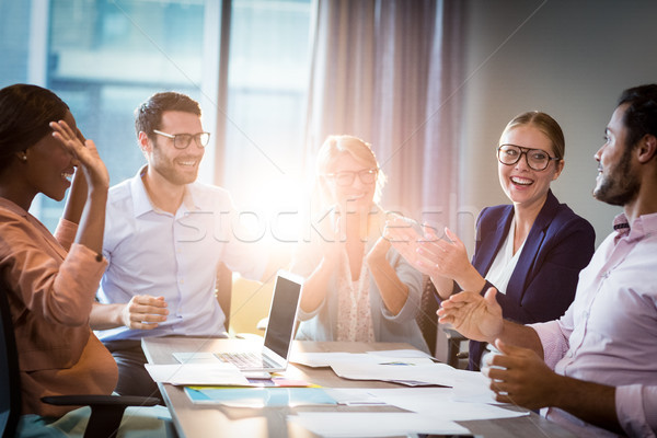 Coworkers applauding a colleague during a meeting Stock photo © wavebreak_media