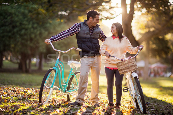Stock photo: Full length of couple with bicycles