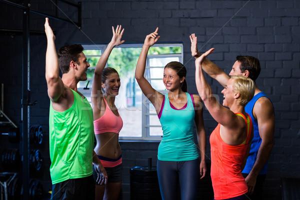 Smiling athletes giving high-five  Stock photo © wavebreak_media