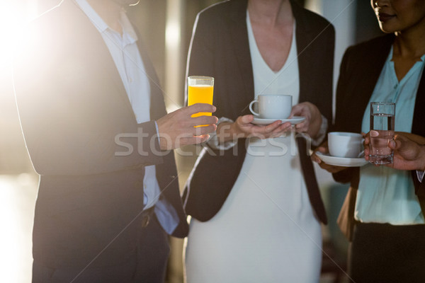 Businesspeople interacting during a break in the office Stock photo © wavebreak_media