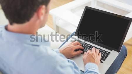 техник используя ноутбук внимательный сервер комнату компьютер Сток-фото © wavebreak_media