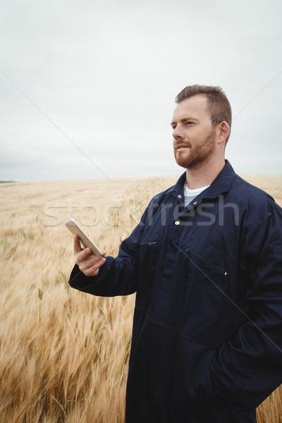 Farmer using mobile phone in the field Stock photo © wavebreak_media