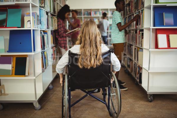 Gehandicapten meisje rolstoel bibliotheek school kind Stockfoto © wavebreak_media