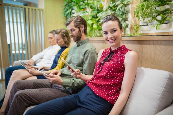 бизнеса электронных сидят служба Сток-фото © wavebreak_media