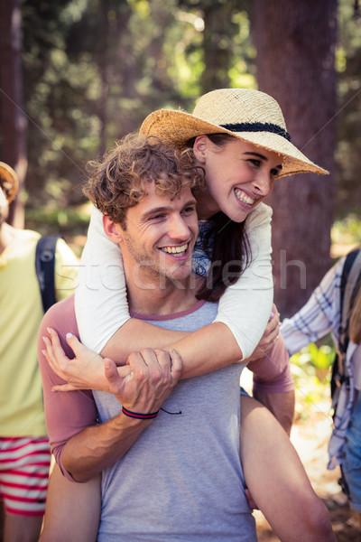 Férfi háton nő erdő napos idő boldog Stock fotó © wavebreak_media