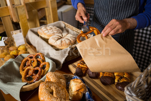 Mid section of staff packing croissant in paper bag at counter Stock photo © wavebreak_media