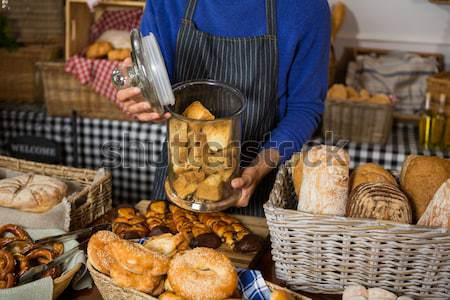 Portrait of male staff holding a basket of bread Stock photo © wavebreak_media