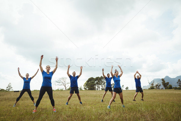 Fit people performing stretching exercise Stock photo © wavebreak_media
