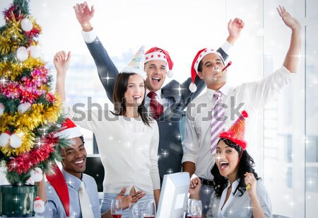 Nice business team punching the air to celebrate christmas  Stock photo © wavebreak_media