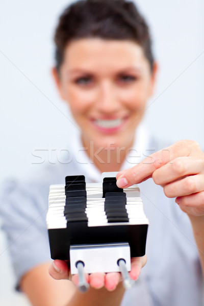 Stock photo: Attractive Business woman searching for the index