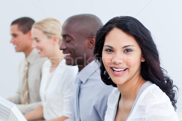 брюнетка деловая женщина работа в команде служба женщину работу Сток-фото © wavebreak_media