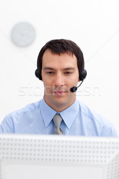 Sério empresário fone branco negócio telefone Foto stock © wavebreak_media