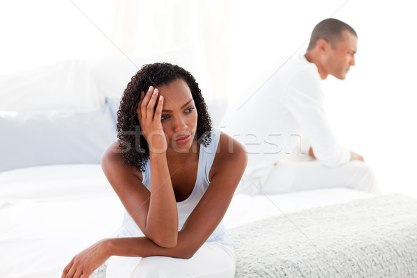 Upset young couple sitting on bed separately Stock photo © wavebreak_media