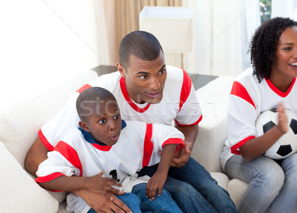 Famille heureuse regarder football match maison femme Photo stock © wavebreak_media
