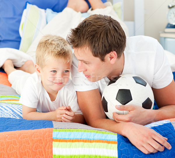 Attentive father and his son playing with a soccer ball  Stock photo © wavebreak_media
