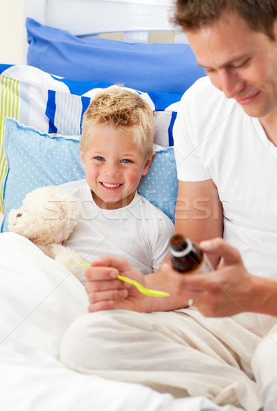 улыбаясь отец кашлять сироп больным сын Сток-фото © wavebreak_media