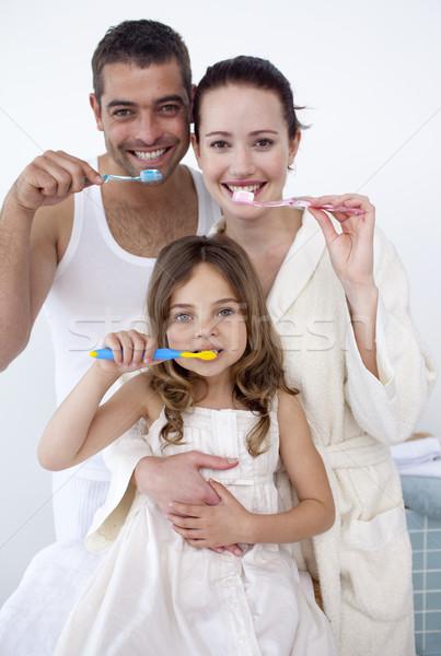 Parents and daughter cleaning their teeth in bathroom Stock photo © wavebreak_media