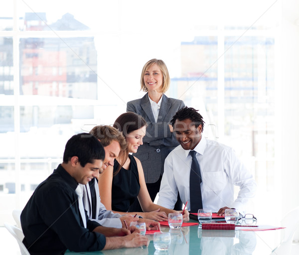 Female manager with her team in a meeting Stock photo © wavebreak_media