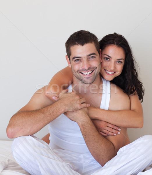 Lovers embracing lying in bed Stock photo © wavebreak_media