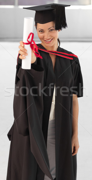 young woman Graduating holding her Diploma Stock photo © wavebreak_media