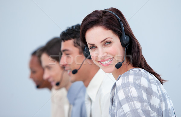 Attractive business woman and her team working in a call center in a company Stock photo © wavebreak_media