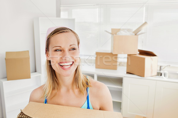 Radiant woman holding boxes after moving  Stock photo © wavebreak_media