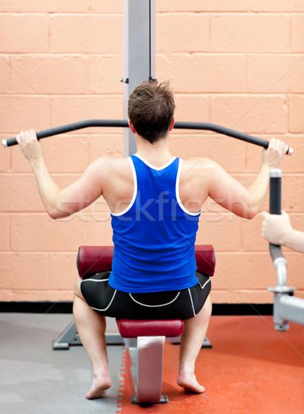 Assertive male athlete practicing body-building in a fitness center Stock photo © wavebreak_media