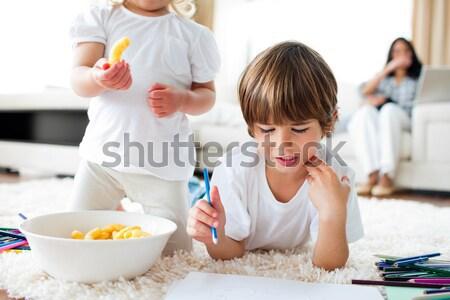 Attentive mother breaking a boiled egg for her son during breakfast Stock photo © wavebreak_media