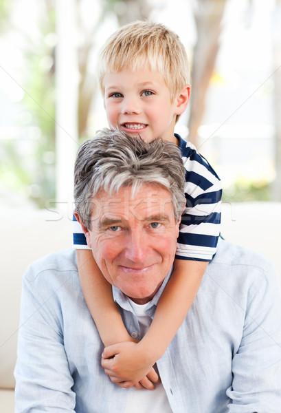 Kicsi fiú nagyapa néz kamera család Stock fotó © wavebreak_media