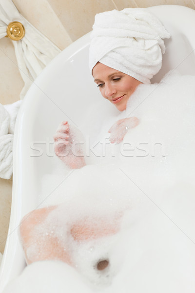 Lovely woman taking a bath with a towel on her head  Stock photo © wavebreak_media