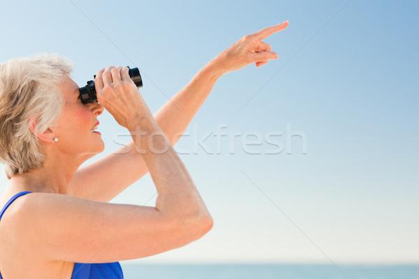 Senior woman bird watching at the beach Stock photo © wavebreak_media