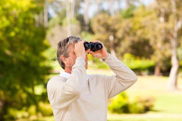 Mature man birds watching Stock photo © wavebreak_media