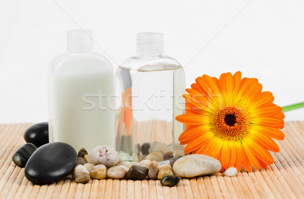 Sunflower with  round smooth pebbles and glass bottles Stock photo © wavebreak_media