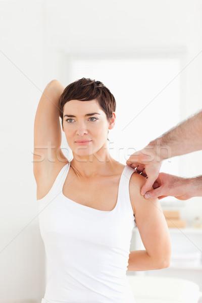 Brunette Patient doing some exercises under supervision in a room Stock photo © wavebreak_media