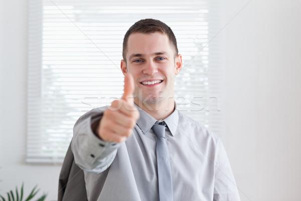 Feliz sonriendo empresario aprobación oficina trabajo Foto stock © wavebreak_media