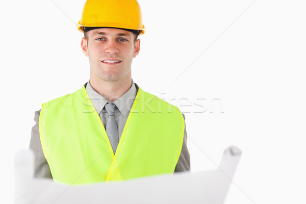 Builder holding a plan against a white background Stock photo © wavebreak_media