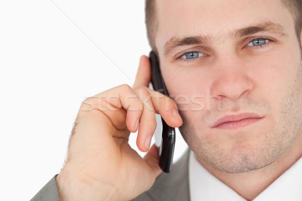 Közelkép fókuszált üzletember készít telefonbeszélgetés fehér Stock fotó © wavebreak_media