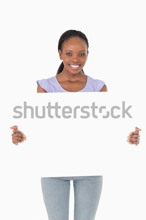 Close up of smiling woman presenting placeholder on white background Stock photo © wavebreak_media