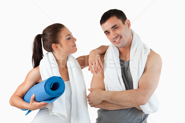 Young couple going to practice yoga against a white background Stock photo © wavebreak_media
