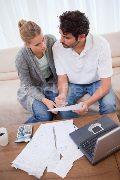 Portrait of a young couple doing their accounting with a notebook in their living room Stock photo © wavebreak_media