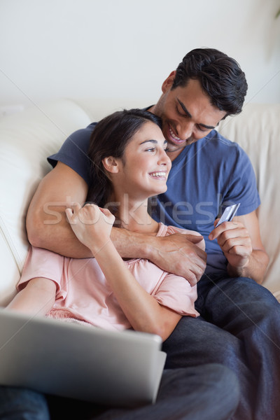 Portrait of a lovely couple booking their holidays online in their living room Stock photo © wavebreak_media
