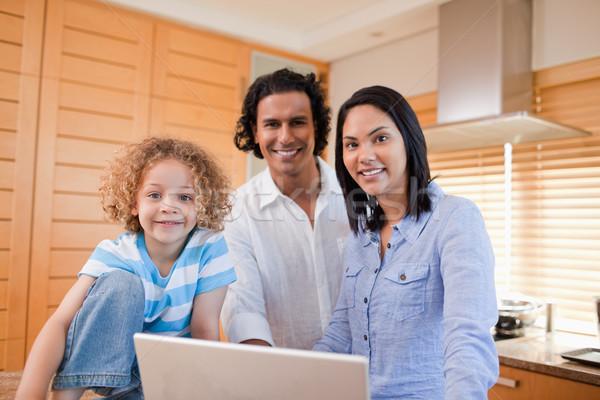радостный молодые семьи серфинга интернет кухне Сток-фото © wavebreak_media
