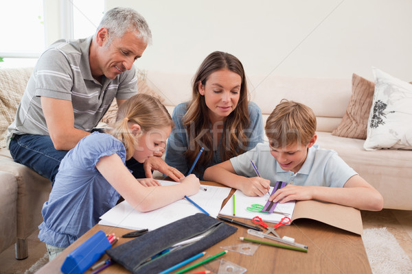 Pais ajuda crianças lição de casa sala de estar família Foto stock © wavebreak_media