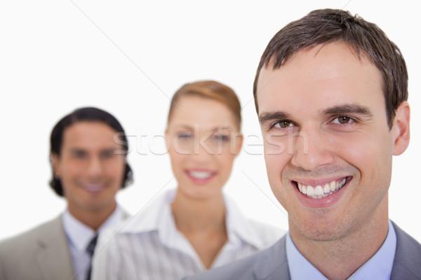 Glimlachend permanente rij witte achtergrond Stockfoto © wavebreak_media