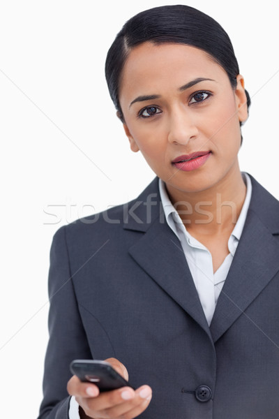 Close up of saleswoman holding cellphone against a white background Stock photo © wavebreak_media