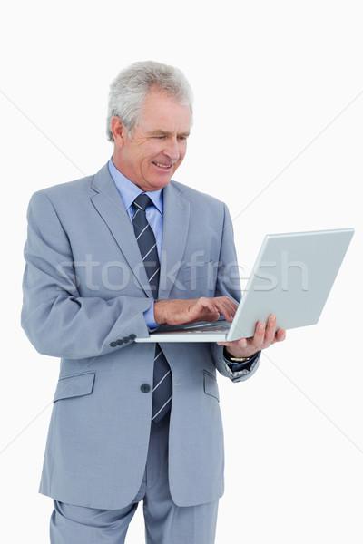 Uśmiechnięty dojrzały handlowiec pracy laptop biały Zdjęcia stock © wavebreak_media