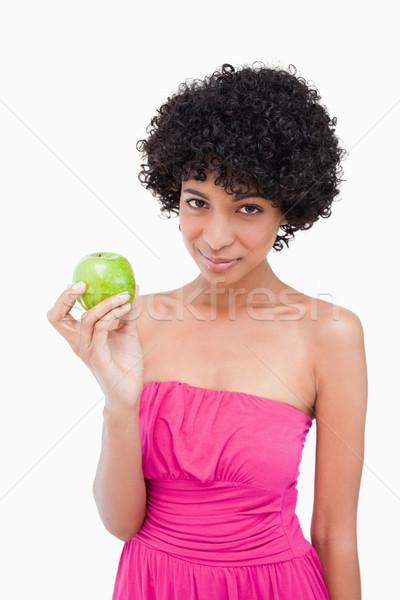 Gyönyörű tinédzser tart zöld alma néz Stock fotó © wavebreak_media